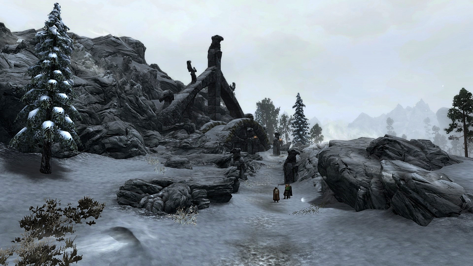 Adventurers stand outside High Gate Ruins in Skyrim